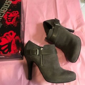 Grey heeled buckle booties